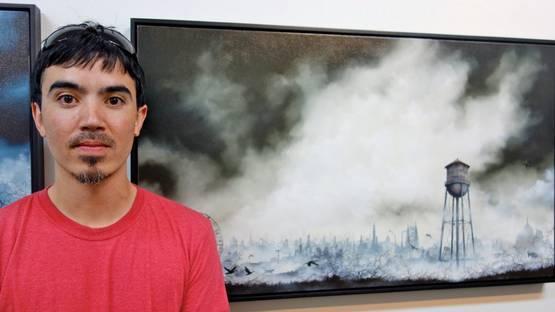 Brian Mashburn in front of his artwork - Photo via arrestedmotioncom