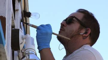 Bumblebeelovesyou - Photo of the artist working - Image via carlsbadcrawlcom