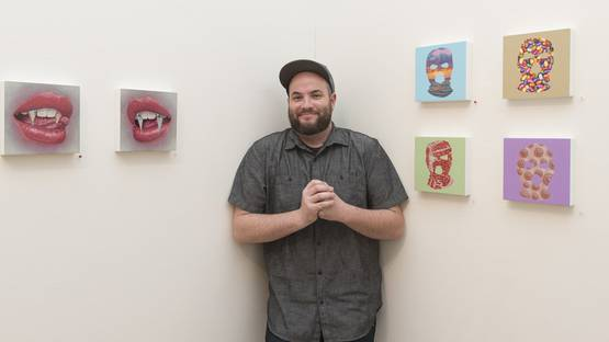 Casey Weldon - in front of his work, photo via arrested motion com