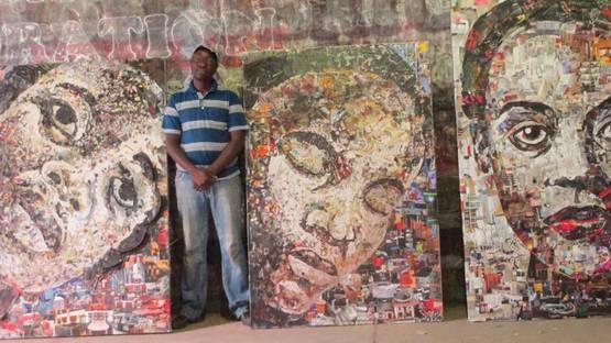 Dario Manjate in front of his work - image courtesy of djartstudiogallery.wordpress.com