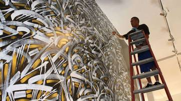 Defer - Working on a piece, image courtesy of the artist