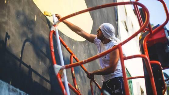 Fikos working on a mural for Bukruk Urban Arts Festival, photo credits Aline Deschamps
