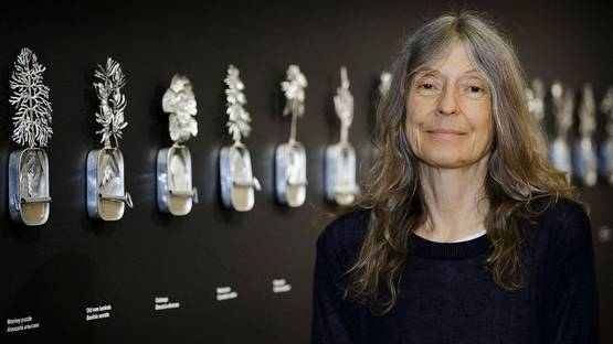 Fiona Hall in front of her art, photo via lostateminor com