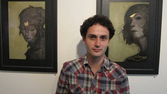 Joao Ruas - Photo of the artist in front of his work - Image via arrestedmotion