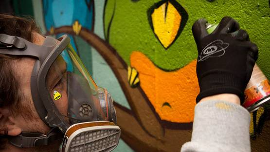 Lacmo working on a mural