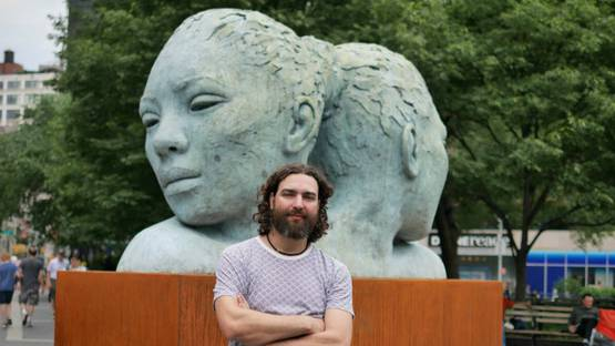Lionel Smit in front of his sculpture at Union Square, NYC, 2016