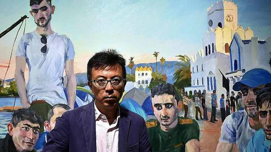 Liu Xiaodong - Artist in front of a work from his Migration series, 2016 - Image via straitstimes