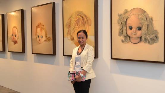 Marina Cruz - Artist with her whimsical doll head paintings - Image by Peter C