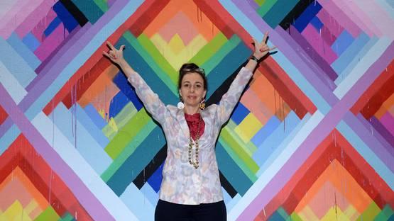 Maya Hayuk - In front of her mural - Photo by Dimitrios Cambouris, via hufftingtonpostcom