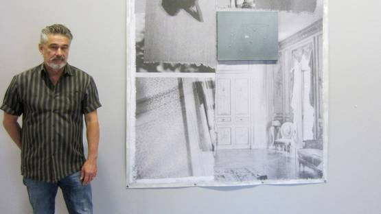 Michael Byron in front of one of his pieces, photo via goodartnews