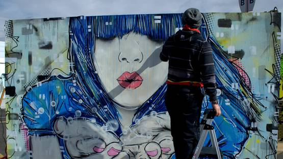 Michael Ortiz paints at Snowball 2014, photo by Lindsey Bartlett