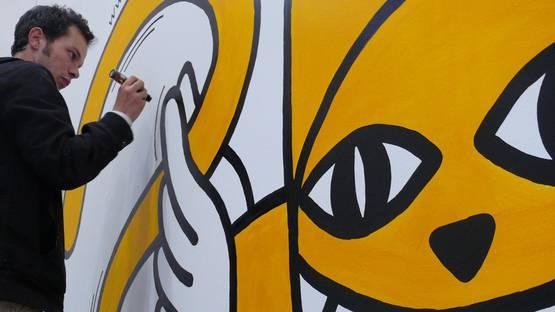 Monsieur Chat working on a piece, image courtesy of Jef Aerosol