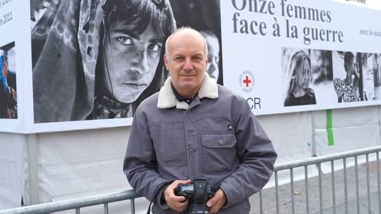 Nick Danziger at the exhibition on the steps of the City Hall in Paris, 2011 - image via shorthandcom