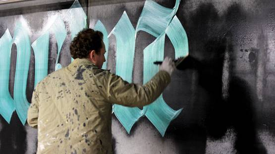 Niels Shoe Meulman working on Unrulyrics project in Amsterdam - image courtesy of Calligraffiti