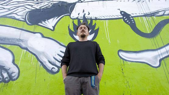 OZMO in front of his Untitled mural in San Francisco, 2016, photo credits Jon Sadgilany