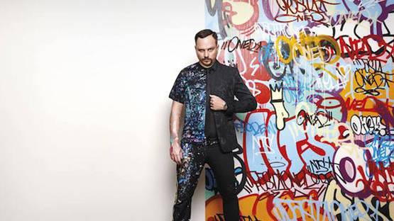 Pasta Oner - Photo of the artist in front of his work - Image courtesy of The Urban Spree Gallery