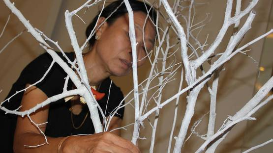 Phyu Mon is installing her artwork, Song from the nature