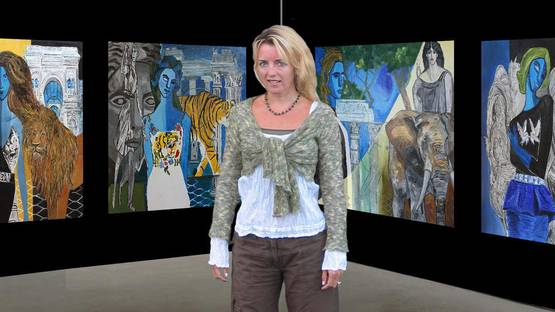 Portrait of Claire Milner in front of her artworks