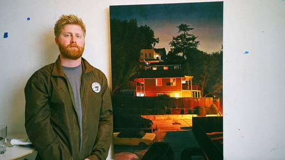 Seth Armstrong in front of his artwork - Photo via funkhausus