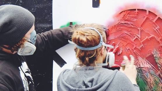 Snik working on a piece - image courtesy of the artist