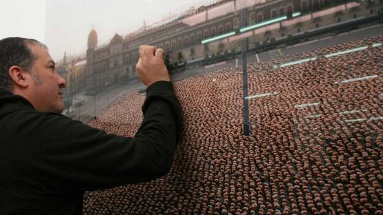 Spencer Tunick with one of his artworks