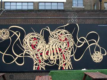 Otto Schade - The Kiss, London, 2009 - Image source Street Art United States interview