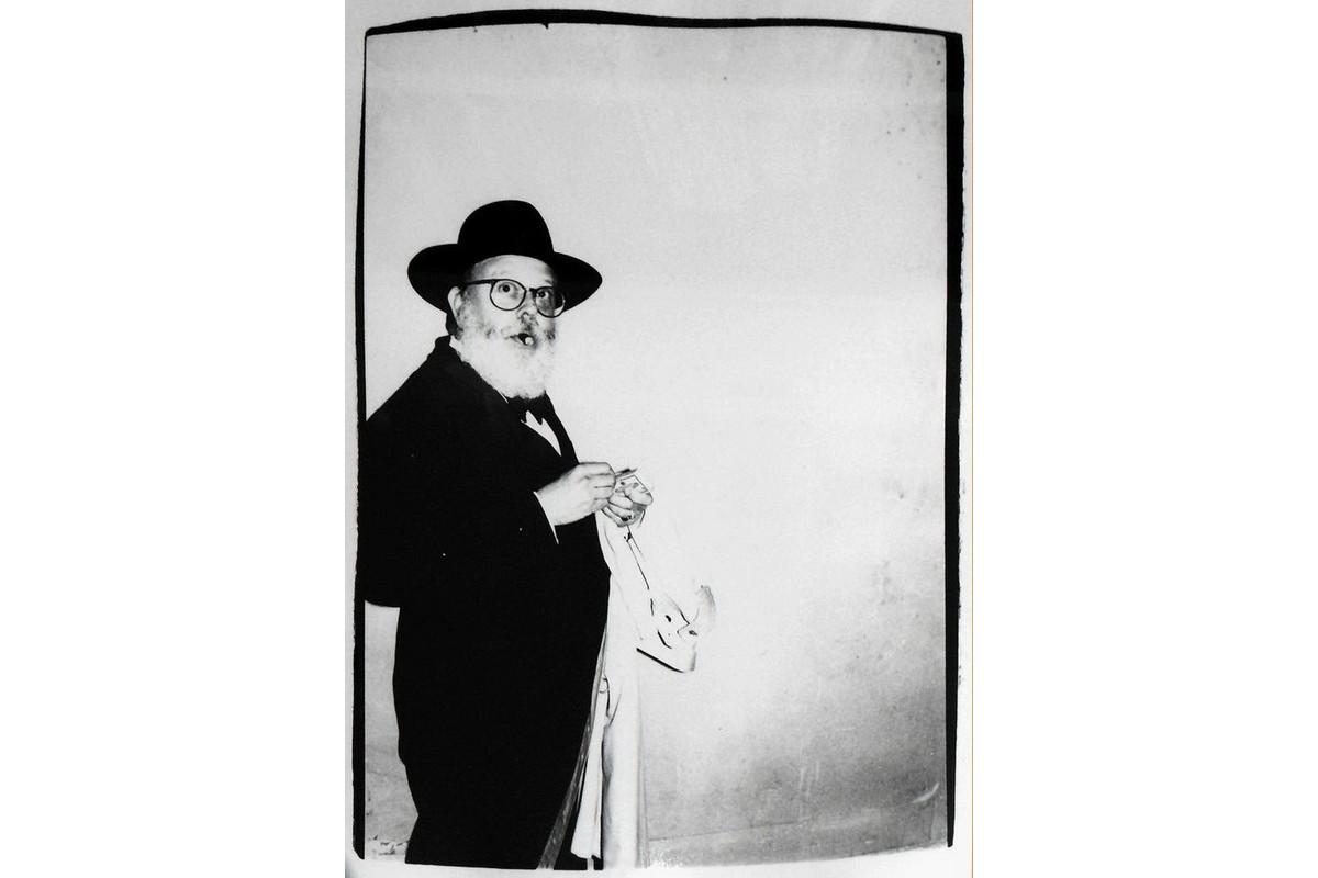 Andy Warhol - Photograph of Henry Geldzahler Lighting a Cigar