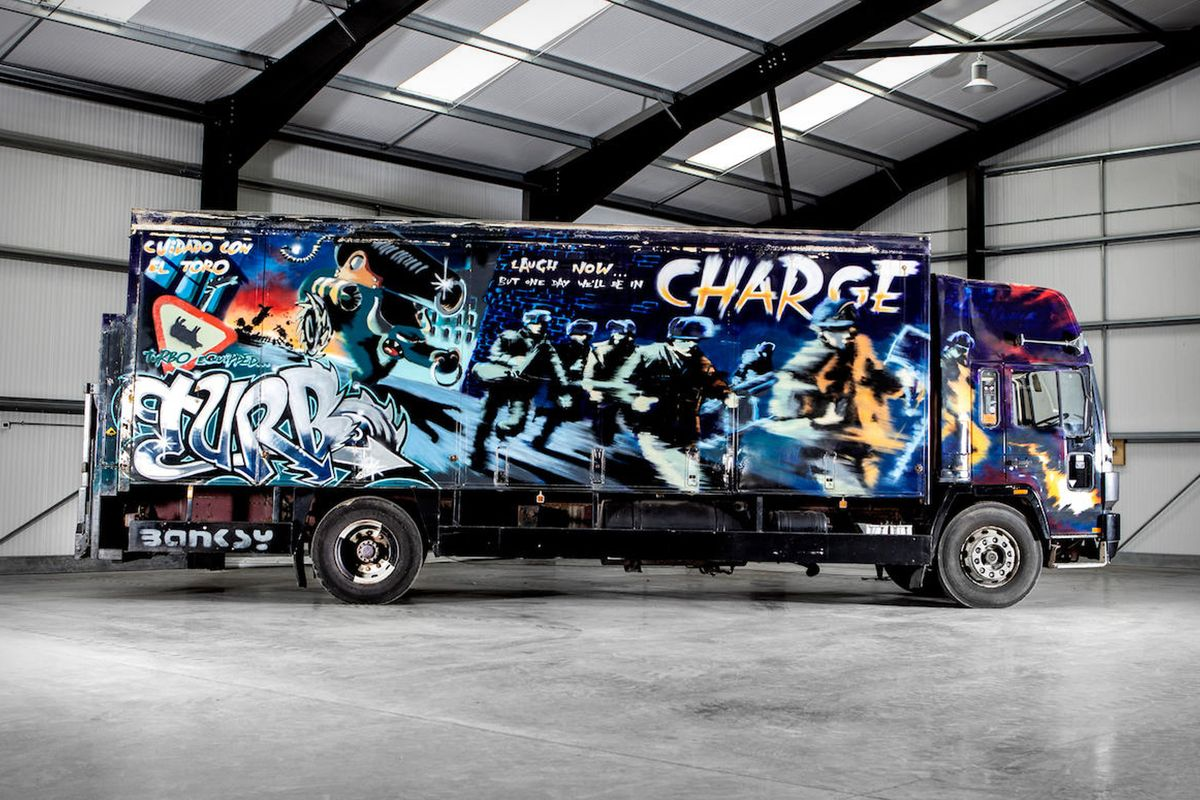 Banksy, Turbo Zone Truck. Laugh Now But One Day We'll Be in Charge, 2000. Estimate- £1,000,000-1,500,000.