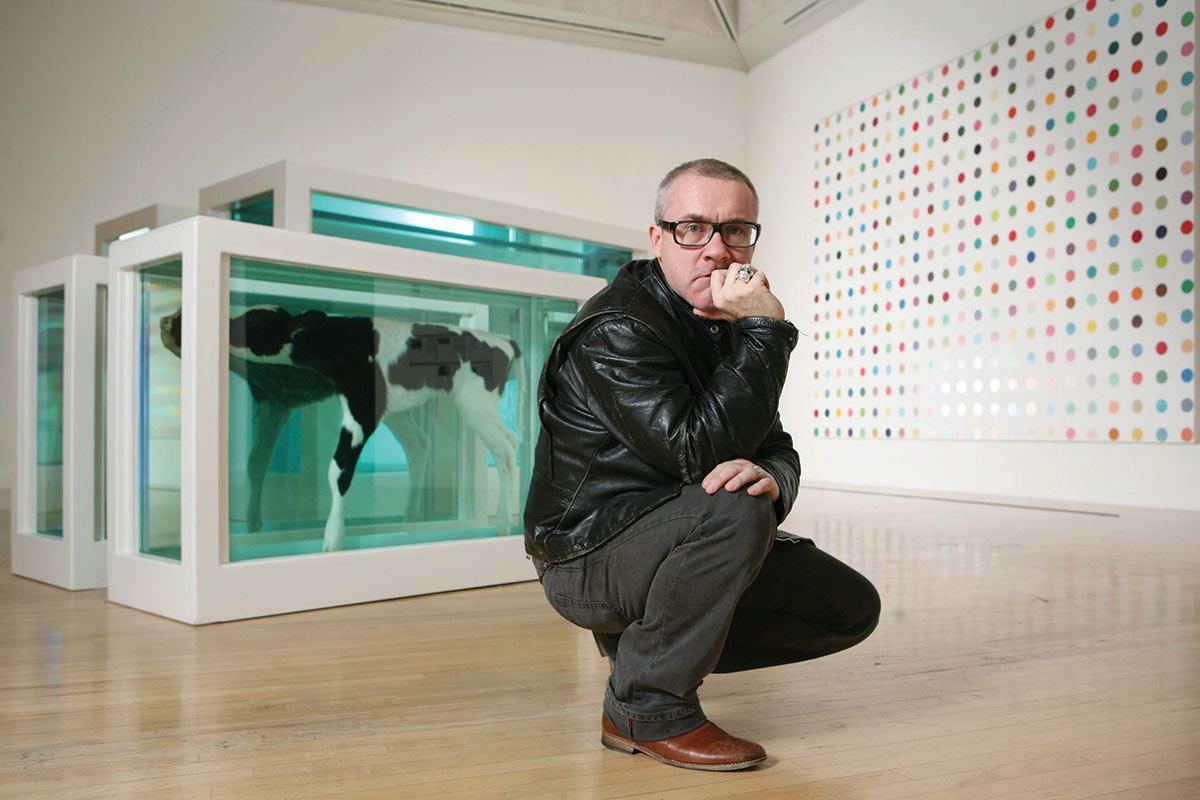 Damien Hirst next to his Mother and Child, Divided. Image via redbrick.me