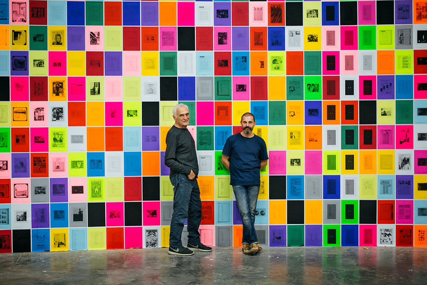 """John Giorno, left, and Ugo Rondinone at the exhibition """"I ♥ John Giorno,"""" at the Palais de Tokyo in Paris in 2015. Credit Alex Cretey-Systermans for The New York Times"""