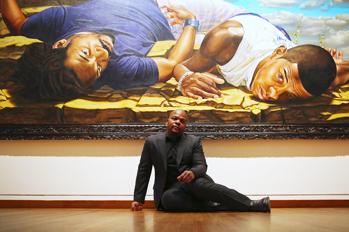 "Kehinde Wiley at the press preview of his show at Seattle Art Museum called ""A New Republic,"" Tues., Feb. 9, 2016, in Seattle. Wiley is by his work ""Santos Dumont--The Father of Aviation II,"" from the series The World Stage: Brazil, 2009  (Ken Lambert / The Seattle Times)"