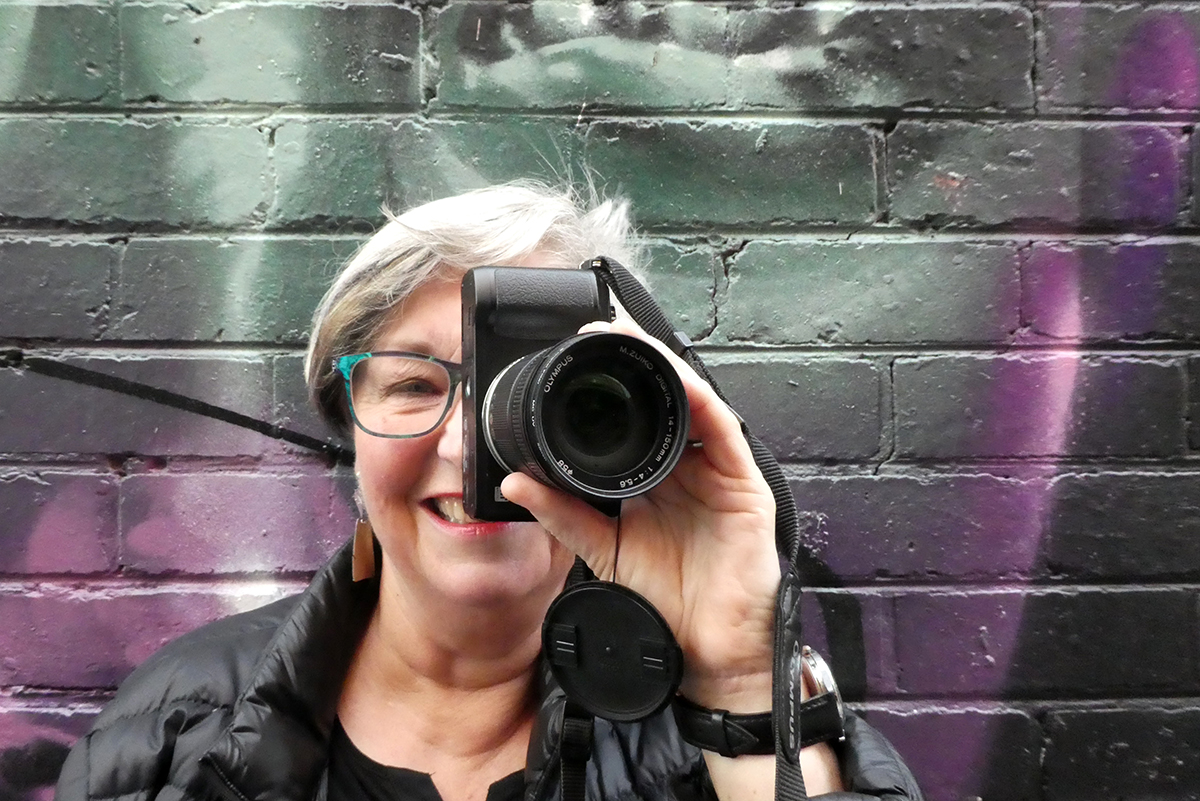 Self-portrait of Lou Chamberlin in front of a wall by Steve Cross, Melbourne