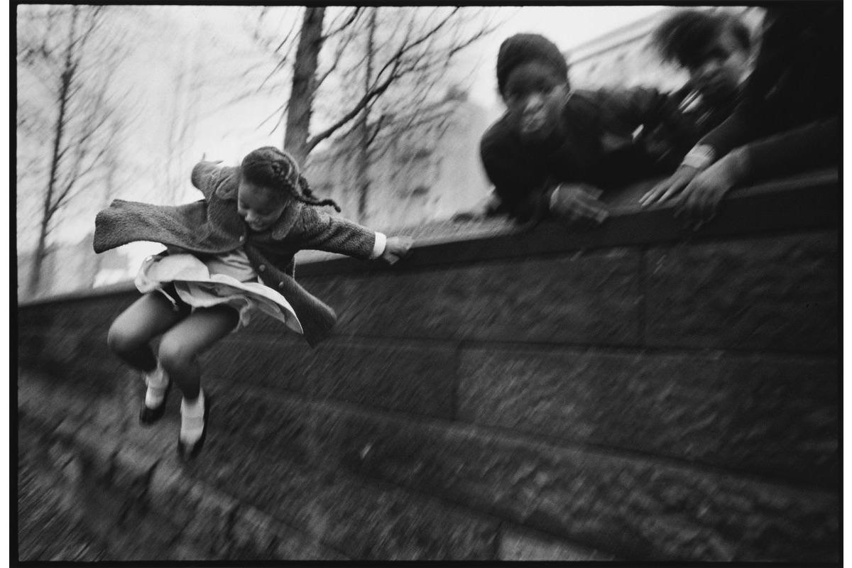 Mary Ellen Mark - Girl Jumping over a Wall, Central Park, New York City, 1967
