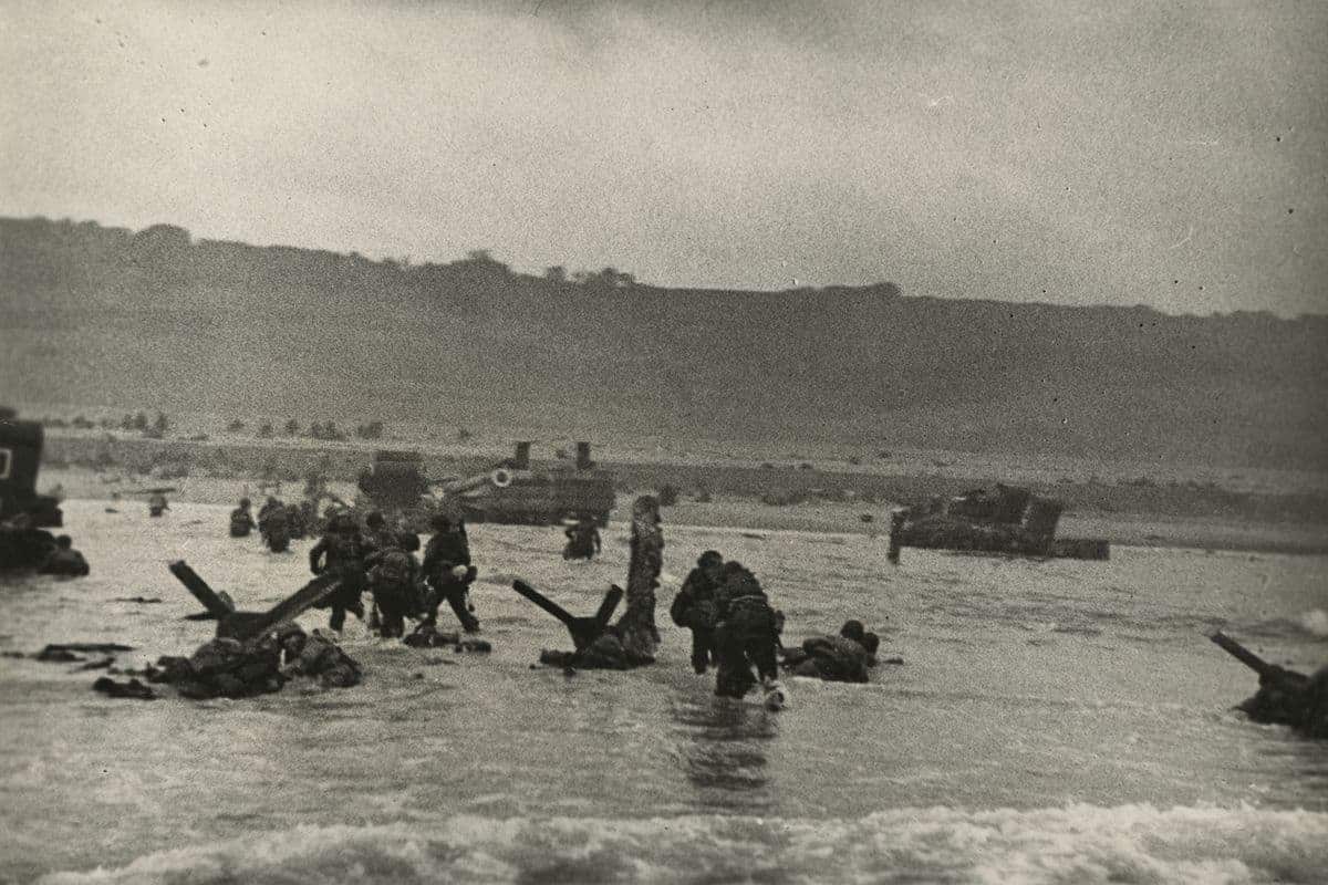 Robert Capa, American soldiers landing on Omaha Beach, D-Day, Normandy, France, June 6, 1944