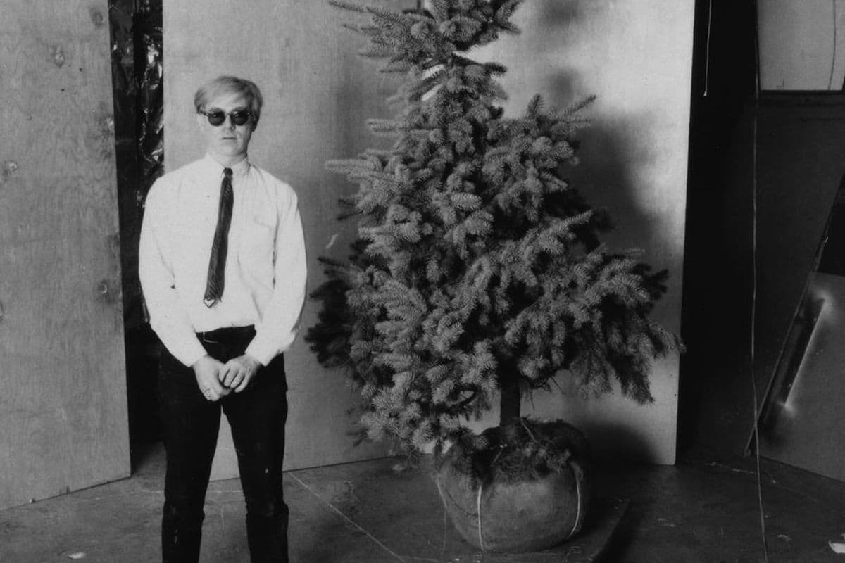 Unknown photographer, Andy Warhol and his Christmas tree in the Factory, 1964, via pinterest.com