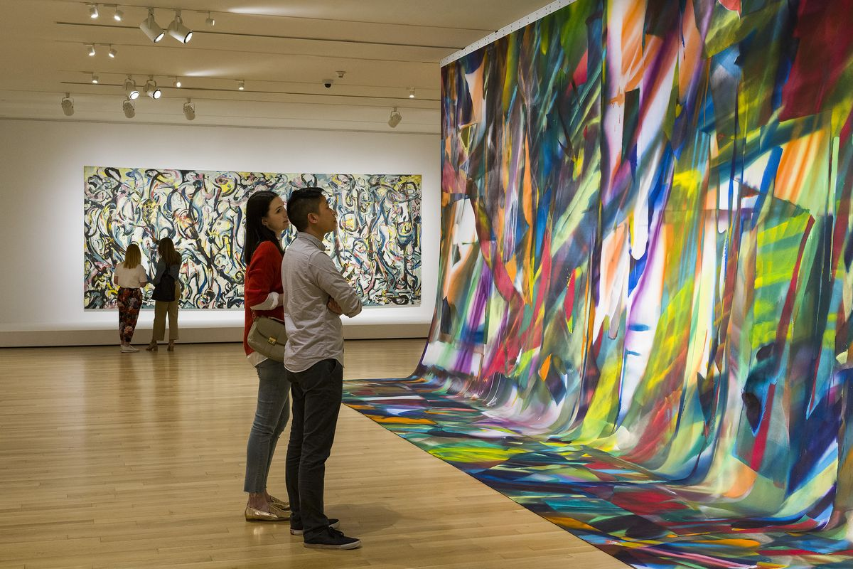 Visitors in the exhibition Mural- Jackson Pollock | Katharina Grosse at the Museum of Fine Arts, Boston
