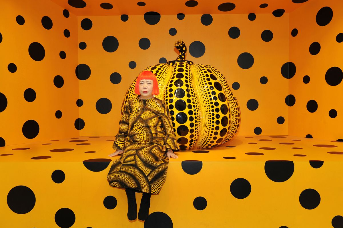 Yayoi Kusama in front of her Pumpkin f