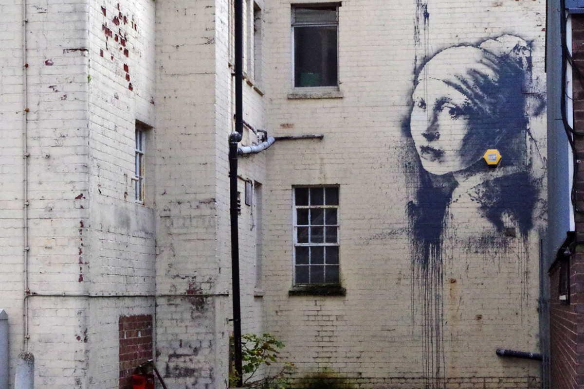 Banksy - Girl with a pierced eardrum, Bristol, UK 2014