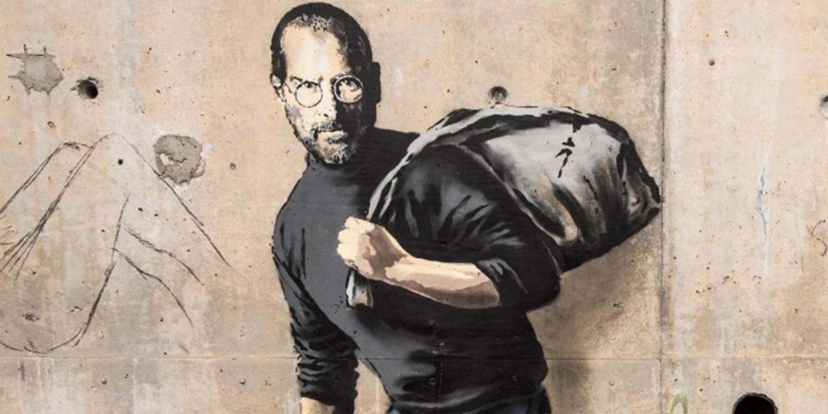 Banksy - Steve Jobs in Calais, 2015 photo via www.theguardian.com